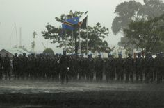 Goma, DR Congo: Image of a medal parade for the MONUSCO Indian battalion going on without stopping, despite the rain coming down and strong wind blowing. Photo MONUSCO archives.