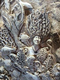 Under water bas-relief by Ellie Ellis, CMS. Self portrait re- sculpted as the mermaid.An artistic humor.