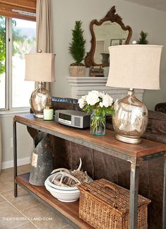 A rustic sofa table that's been styled in a relaxed, country design style