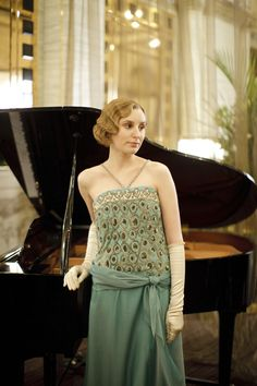 Lady Edith is frequently eclipsed by her sister Mary and her late sister Sybil. Slowly but surely, however, she is beginning to emerge from the shadows and forge her own trajectory of independence. She has a column in The Sketch and her relationship with its married editor Michael Gregson is getting serious, much to the dismay of Mary. However, Gregson's ambitious plans for their future come with far reaching repercussions. Played by Laura Carmichael.
