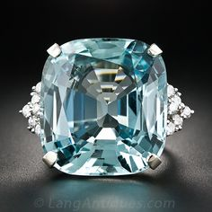 This queen-size, showstopping bauble shines day and night with a fabulous cushion-shape aquamarine weighing approximately 38 carats. The cool blue gemstone glistens between V-shape clusters of sparkling full-cut diamonds, all of which are set in gleaming, sturdy 14K white gol