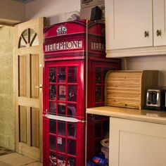 The now infamous Telephone Box FridgeWrap from Vinyl Revolution. Transform your fridge into a classic red British telephone box today.