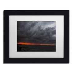 This ready to hang, matted framed art piece features storm clouds over Lake Erie…
