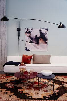 What lovely pale blue walls. I like the contrast of that with the black, tan and rust.