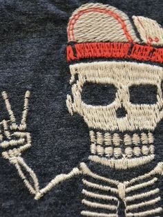 "A detail from an embroidered T-shirt called ""Resilient Heroes"" by Vivabone."