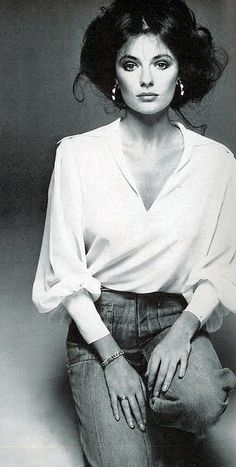 Vogue Dec. 1973, Jacqueline Bissett in her own blue jeans with georgette poet's shirt by Geoffrey Beene, photo by Avedon.