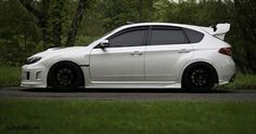 White Subaru with black wheels