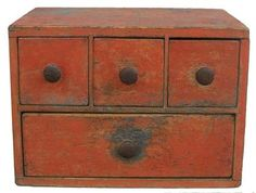"""Early 19th century New England pumpkin painted Apothecary Spice Chest, wonderful small size and form, tee head and square head nails, with one board construction, all original circa 1790-1810  Measurement are 17 1/2"""" wide x 12 1/4"""" deep x 12 1/2"""" tall"""