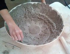 Coils and designs in a bowl, smooth inside, designs remain on the outside. Students love to create large and small bowls this way.-- I use this method frequently. Hand Built Pottery, Slab Pottery, Pottery Bowls, Ceramic Pottery, Pottery Art, Thrown Pottery, Ceramics Projects, Clay Projects, Clay Crafts