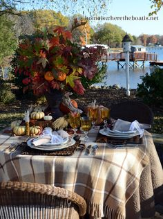 A Last Hurrah for Fall Leaves and Pumpkins with cornucopia folded napkins and a…