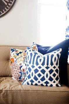 mix of patterns against camel sofa (Imperial Trellis from Etsy) (peacock pillow from Pottery Barn's Bettina fabric) (large navy pillow from DownEast)