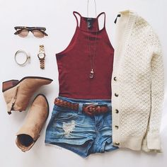 Red halter top, denim shorts, cream cardigan, and boots