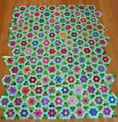 modern grandmothers flower garden quilt from Stephanie Serrano at Venus de Hilo.  Love that it's not white!
