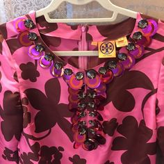 GORGEOUS RASPBERRY TORY BURCH TUNIC Total stunner piece! Can you imagine the possibilities? Flat sequin circular pieces along with faux crystal neckline accent detail. Comes from a clean and smoke free home. Price is firm. Tory Burch Tops Tunics