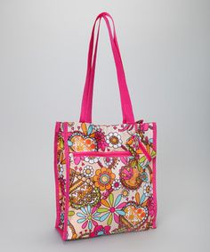 The perfect marriage of fashion and functionality, this roomy tote boasts a vibrant print and wide double handles. The large interior features a zippered pocket and securely closes with a zipper and hook and loop combination. Two exterior pockets and a mesh side pouch offer extra room for school supplies or farmers' market finds, while the detachable coin purse keeps spare change and cards close at hand.