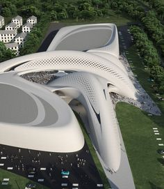Jesolo Magica, Jesolo, ITALY. Design by Zaha Hadid Architects. The architect describe the center as a catalyst for reinvention  – a fluid but coherent field of buildings – each separate but all logically connected in a continually changing ensemble – the volumes encompassing the new retail centre in the seaside town of Jesolo open up around a central space like the petals of a flower.