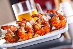 This Spicy Grilled Shrimp Skewer Recipe packs quite a punch and will be a sure hit at your next BBQ. The key to this recipe is the intense flavor the shri . Barbecued Prawns, Bbq Prawns, Garlic Prawns, Garlic Recipes, Shrimp Recipes, Fish Recipes, Low Carb Recipes, Cooking Recipes, Uk Recipes