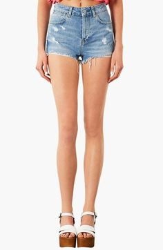 $68, Light Blue Denim Shorts: Topshop Moto Ruthie Distressed Denim Shorts. Sold by Nordstrom. Click for more info: https://lookastic.com/women/shop_items/52914/redirect