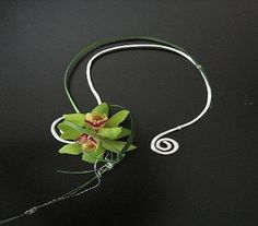 Stunningly simple, this orchid necklace is a striking way to stand out in the crowd! $39.99 and up.