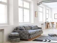 Upholstery fabrics, cushions and area rugs by Johanna Gullichsen