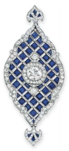 Christie's Magnificent Jewels – Art deco sapphire diamond pendant Designed as a flexible square-cut sapphire tapered panel, set at the center with an old European-cut diamond within a single and old European-cut diamond surround, to the single and old European-cut diamond scalloped trim, mounted in platinum, circa 1920, with hoop for suspension