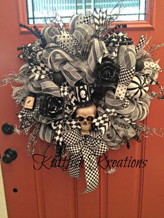 Skeleton Deco Mesh Wreath with flashing eyes -- Custom Order -- SOLD https://www.facebook.com/Kattfish-Kreations-659509324079375/