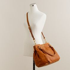 J Crew The perfect blend of elegant and easy wearing, our iconic hobo is back in an array of amazing hues and leathers, including a beautifully textured pebbled version. With its must-have detachable shoulder strap and not-too-big-not-too-small size, it's as irresistible as ever. Classic leather (henna) or pebbled leather (warm burgundy, true black, sandstone). Turnlock closure. Antiqued gold-finish hardware. Interior zip pocket, split-patch cell pocket. Cotton twill lining. Part of J.Crew…