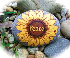 """""""Peace"""" Sunflower painted on a stone"""