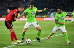 Mario Gomez Photos Photos - Mario Gomez of Wolfsburg is challenged by Janik Haberer of Freiburg during the Bundesliga match between VfL Wolfsburg and SC Freiburg at Volkswagen Arena on April 5, 2017 in Wolfsburg, Germany. - VfL Wolfsburg v SC Freiburg - Bundesliga
