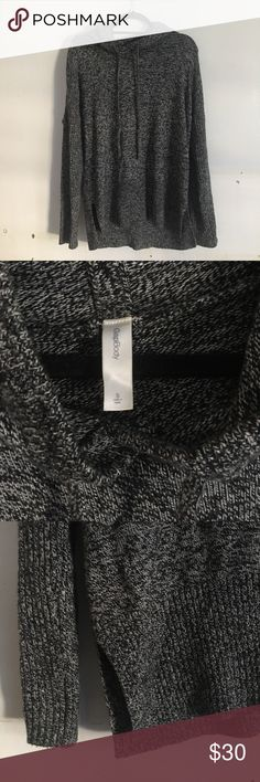 Dark grey speckled hoodie Very soft dark grey speckled hoodie from the Gap. Worn only a couple of times, very comfortable and slightly oversized. Slits on bottom of hem. 45% Nylon, 28% cotton, 27% wool GAP Tops Sweatshirts & Hoodies