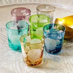 Set of 6 coloured glasses with etched floral designs, perfect for tealights, candles, or even cocktails!