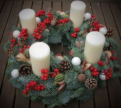 www.brigitteflowers.co.uk  Advent wreath made with fresh pine, Ilex, pinecones and white bubbles. Made by Brigitte de Wert