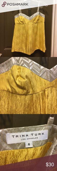 Trina Turk yellow silk tank sz 4 Trina Turk yellow silk tank w silver contrast sz 4. Gently worn. Beautiful silk tank w adjustable spaghetti straps and zipper down back. Excellent condition.  Bundle for savings! Trina Turk Tops Tank Tops