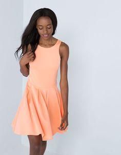 Orange neopren dress from Bershka.