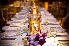 An elegant runner of florals and candles down 16' feast tables at the Please Touch Museum. {Design: TableArt | Photo: Shea Roggio Photography}