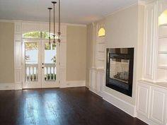 Elevated fireplace, granite surround, wood storage | Fireplace ...