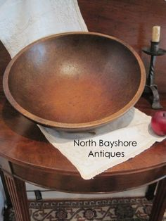 Items in North Bayshore Antiques is an online antique and auction gallery located just outside the first town in the first state of Delaware.  We travel the east coast seeking American colonial and country antiques and primitives from the 17th, 18th, and 19th centuries.  We specialize in early wrought iron lighting; wooden dough bowls, trenchers, and kitchen treen; cast iron open hearth cookware, copperware; document, candle, and other wooden boxes and chests, stoneware cobalt glaze crocks…