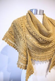 FREE Knitting Pattern • A large, warm shawl knit in DK weight lambswool yarn. The body of the shawl is completed first, starting with 3 sts and increasing to 309 sts. Next, the lace edging is knit on from side-to-side, no need for sewing!