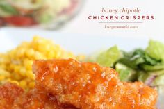 Easy baked chicken tenders smothered in a sweet, tangy honey chipotle sauce! Simply delicious! | LoveGrowsWild.com