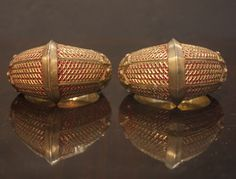 Pair of armlet from Minangkabau. Sumatra, 19th Century. High karat gold with ruby inset. This and more rare jewelry for sale on Curatorseye.com