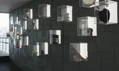 Collider designed a wall of clear, backlit boxes that contain iconic props and wardrobe pieces from the company's productions. Display Design, Wall Design, Display Wall, Display Boxes, Display Ideas, Sydney Theatre Company, Donor Wall, Award Display, Museum Displays