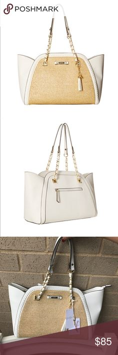 """Jessica Simpson Tote Handbag Made of 100% faux leather. Dual flat carry straps with chain detail. Zip closure. Removable tassel charm. Exterior zip pocket. Flat bottom base. Interior back wall zip pocket with additional slip pockets  Imported. Height approx 11"""" top width approximately 18"""" and bottom width approximately 14"""" . Jessica Simpson Bags Totes"""