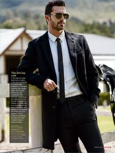 Starring in an editorial for GQ Style South Africa, Clint Mauro rocks a Paul Smith car coat with a Versace shirt and Hugo Boss trousers.