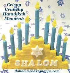 Hanukkah Menorah made from rice krispie treats, colored white chocolate, gum drops and pretzel rods.
