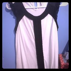 Black and white shirt Beautiful black and white shirt soft material with lace detailing at the shoulder and a cute button closure at the back Elle Tops
