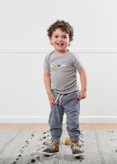 Yummy treats all in a row on this soft grey organic tee. Features snaps at shoulders in infant sizes. See also Ice Cream Sandwich tee. - Materials: 95% Organic Cotton, 5% Elastane - Care: Machine wash