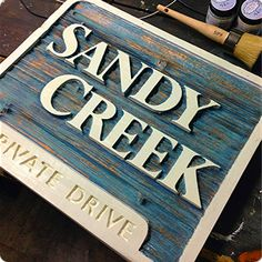 Annie Sloan chalk paint in Aubrusson blue, duck egg blue and copper wax... Old white for the lettering and border