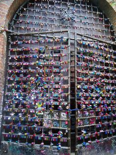 Locks of love at Juliet's house, Verona, Italy even though its a ridiculous play it would still be cool to go there :)