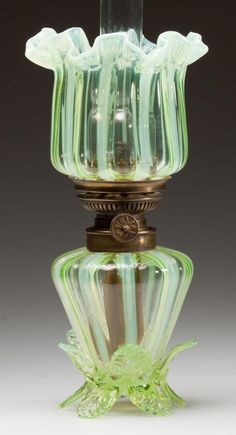 "STRIPED MINIATURE LAMP, vaseline (uranium) opalescent, upturned ruffled shade, base with vaseline applied leaves and feet. Period burner and chimney stenciled ""Lyon"". Fourth quarter century. 9 H to top of shade Antique Oil Lamps, Old Lamps, Antique Lighting, Vintage Lamps, Hurricane Oil Lamps, Chandeliers, Victorian Lamps, Kerosene Lamp, Vaseline Glass"