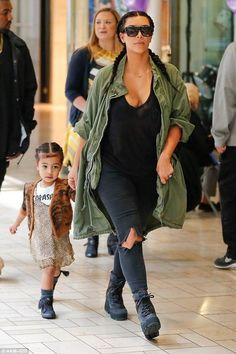 Kim Kardashian wearing J Brand Photo Ready Cropped Mid Rise in Mercy and Yeezy 950 Boots